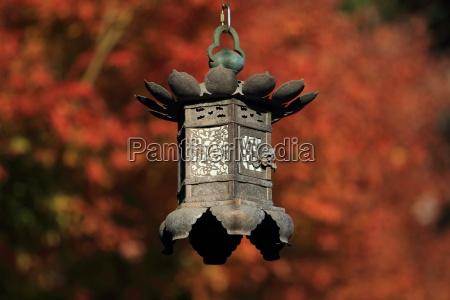 blad tempel lys solbeskinnet lanterne stil