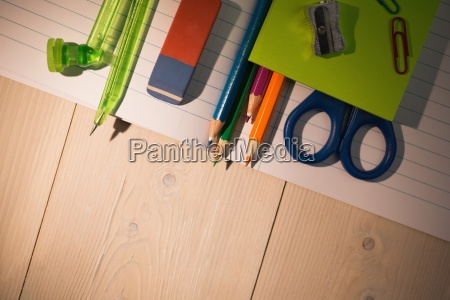 students table with school supplies