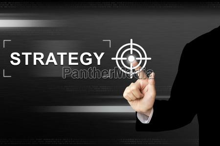 business hand skubber strategi knappen pa