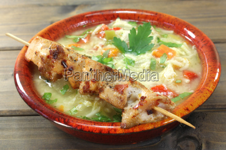 chicken soup with chicken skewers and