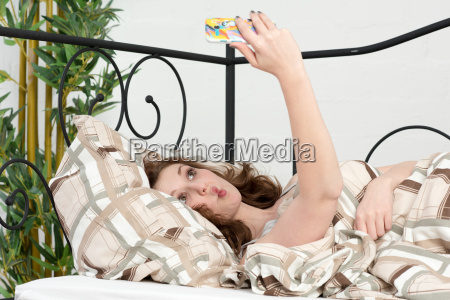 young woman with mobile phone in
