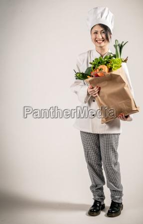 glad chef holding paper bag med