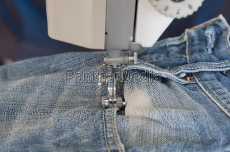 symaskine med tekstiler
