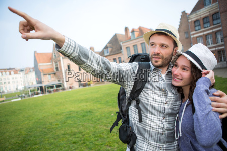 couple of young attractive tourists discovering