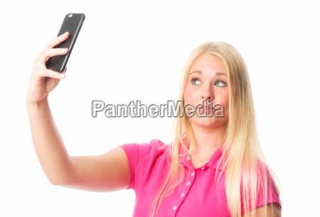 blond girl making a selfie