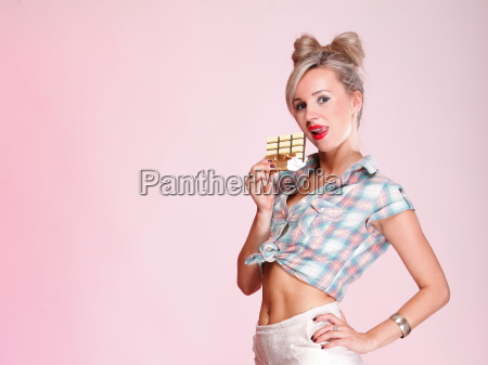 pinup girl woman eating chocolate portrait