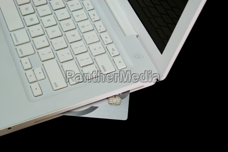 credit card in white laptop