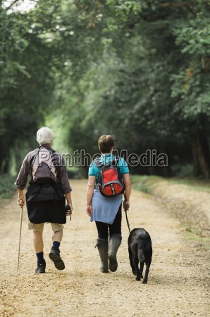 a mature couple hiking with their