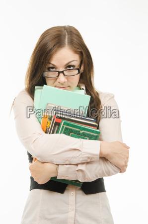streng laerer med boger og notesboger