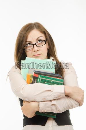 tankevaekkende laerer med laereboger og notesboger