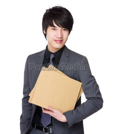 asian young businessman hold with folder