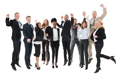 fuld laengde af happy business team