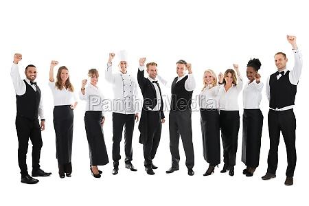 portraet af glade restaurant personale fejrer