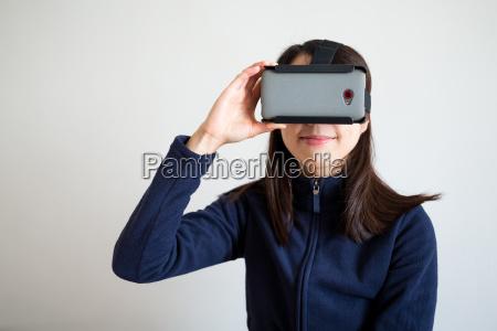 woman watch via virtual reality glasses
