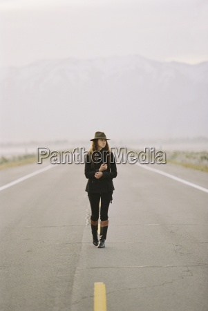 a woman walking down the middle