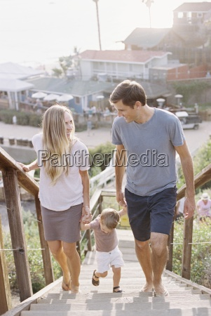couple holding hands with their young