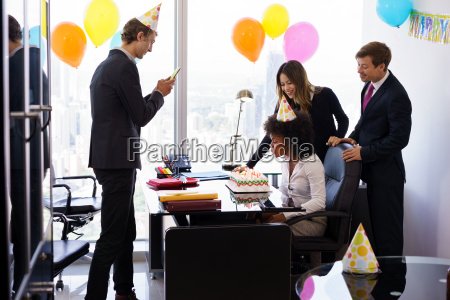 business people celebrating colleague birthday party