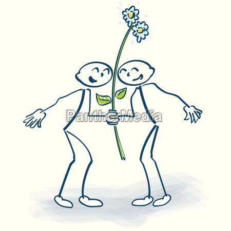 to taendstikmand med en blomst lolly