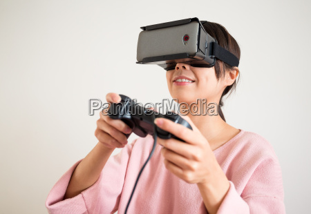 young woman play video game with