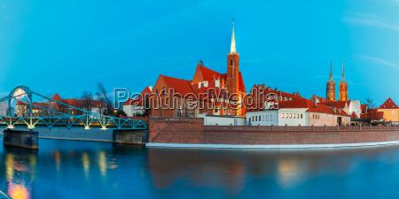 night panorama of tumski bridge wroclaw
