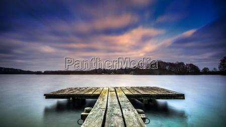 solnedgang lang eksponeringstid mellemstykke vand