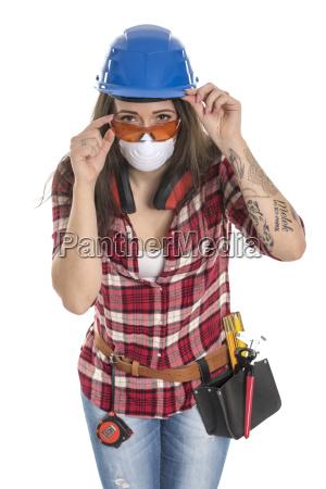 kvindelige handvaerker med beskyttende maske og