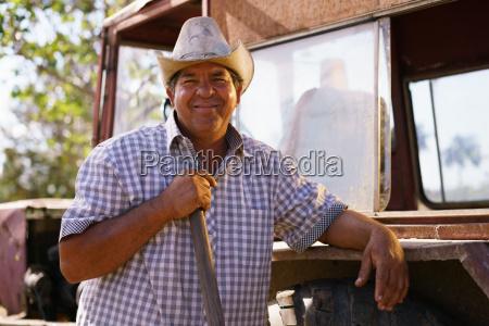 portrait happy man farmer auf traktor
