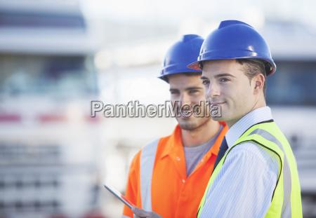 businessman and worker using digital tablet