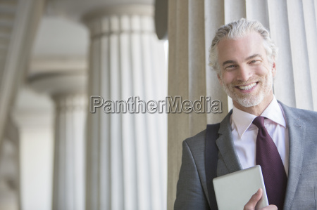businessman smiling outdoors