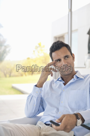 businessman watching television in office