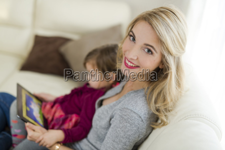 portrait of smiling woman sitting with