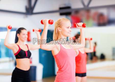 group of smiling women working out