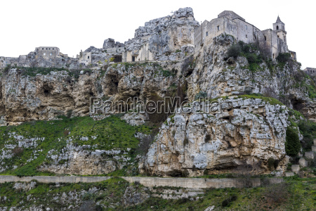 rocky coastal cliffs and matera cathedral