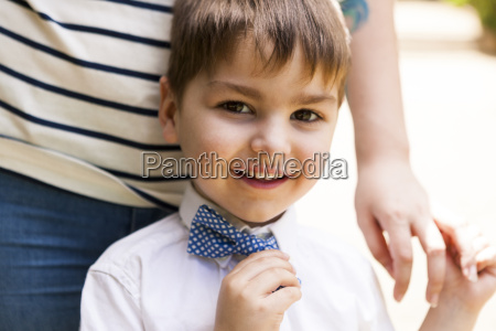 portrait of smiling boy at mothers