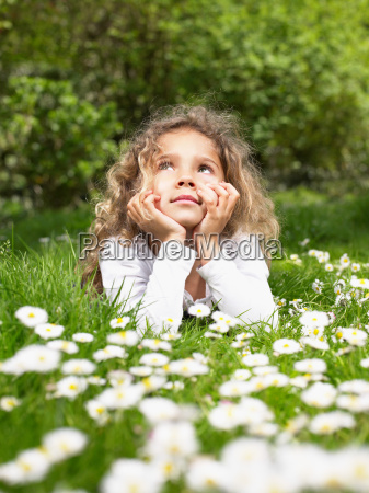 young girl lying in the grass
