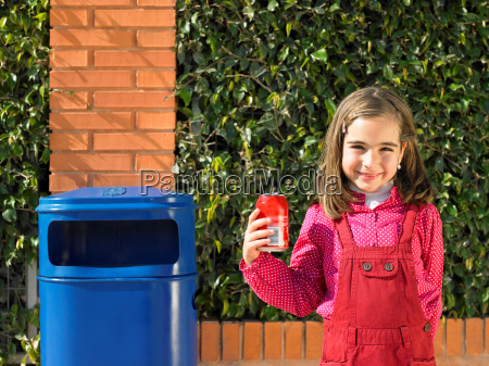 young girl with can next to