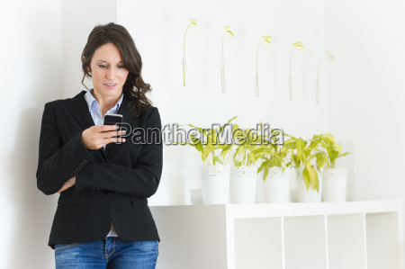 mid adult woman reading text message