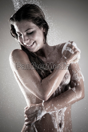 young woman showering studio shot