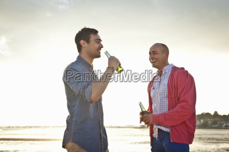 men drinking beer and chatting on