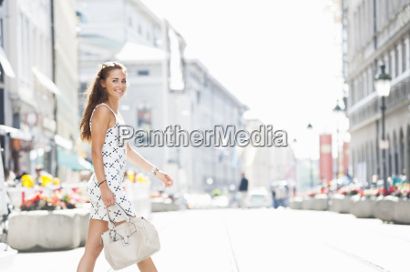 mid adult woman walking outdoors portrait