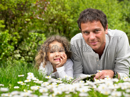 man and young girl lying in
