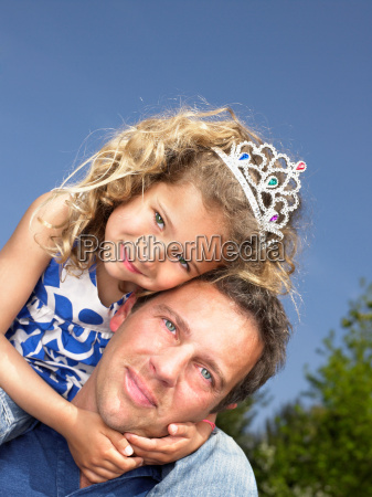 man with smiling young girl