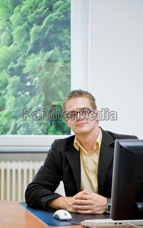 portrait of man on computer in