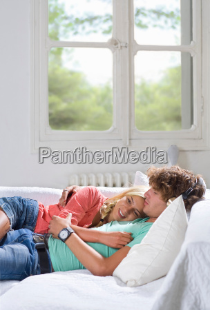 young couple relax on couch at