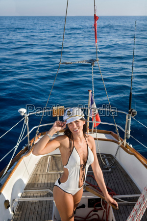 sexy captain woman on sailboat