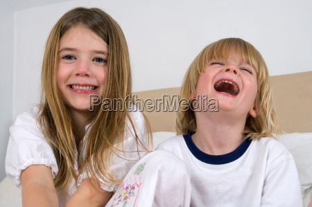 young girl and boy laughing