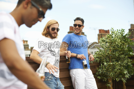 three male friends drinking beer at