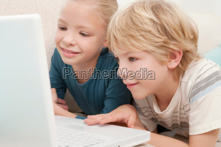 a boy and girl using a