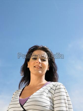 portrait of woman against sky spain