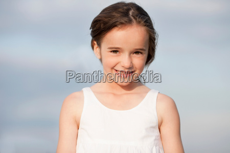 young girl smiling at viewer